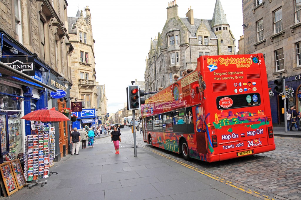 A double decker, tourists bus in the old town of Edinburgh