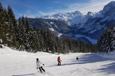Skifahren mit Aussicht auf den Dachstein und den Gosausee.